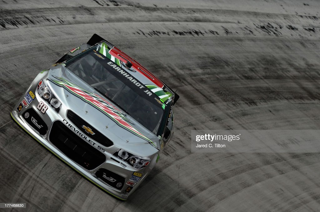 Dale Earnhardt Jr., driver of the #88 Diet Mountain Dew Chevrolet, practices for the NASCAR Sprint Cup Series IRWIN Tools Night Race at Bristol Motor Speedway on August 23, 2013 in Bristol, Tennessee.