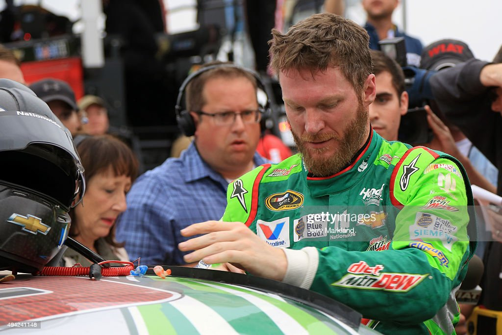 <a gi-track='captionPersonalityLinkClicked' href=/galleries/search?phrase=Dale+Earnhardt+Jr.&family=editorial&specificpeople=171293 ng-click='$event.stopPropagation()'>Dale Earnhardt Jr.</a>, driver of the #88 Diet Mountain Dew Chevrolet, reacts on pit road after the NASCAR Sprint Cup Series CampingWorld.com 500 at Talladega Superspeedway on October 25, 2015 in Talladega, Alabama.