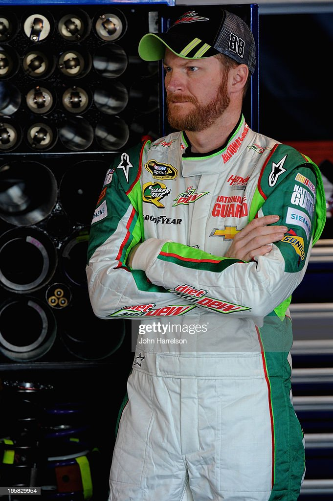 Dale Earnhardt Jr., driver of the #88 Diet Mountain Dew Chevrolet, stands in the garage area during practice for the NASCAR Sprint Cup Series STP Gas Booster 500 on April 6, 2013 at Martinsville Speedway in Ridgeway, Virginia.