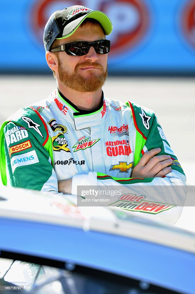<a gi-track='captionPersonalityLinkClicked' href=/galleries/search?phrase=Dale+Earnhardt+Jr.&family=editorial&specificpeople=171293 ng-click='$event.stopPropagation()'>Dale Earnhardt Jr.</a>, driver of the #88 Diet Mountain Dew Chevrolet, stands on the grid during qualifying for the NASCAR Sprint Cup Series STP Gas Booster 500 on April 5, 2013 at Martinsville Speedway in Ridgeway, Virginia.