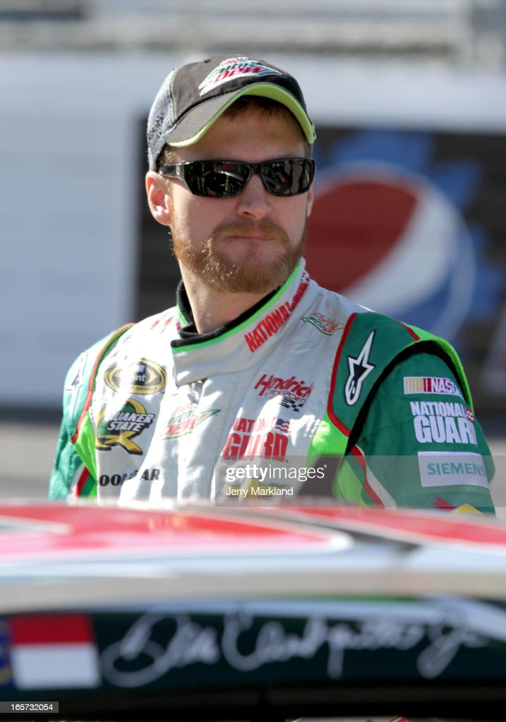 Dale Earnhardt Jr., driver of the #88 Diet Mountain Dew Chevrolet, stands on the grid during qualifying for the NASCAR Sprint Cup Series STP Gas Booster 500 on April 5, 2013 at Martinsville Speedway in Ridgeway, Virginia.