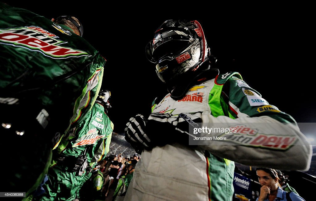 Dale Earnhardt Jr., driver of the #88 Diet Mountain Dew Chevrolet, walks from his car following an incident on track during the NASCAR Sprint Cup Series Irwin Tools Night Race at Bristol Motor Speedway on August 23, 2014 in Bristol, Tennessee.