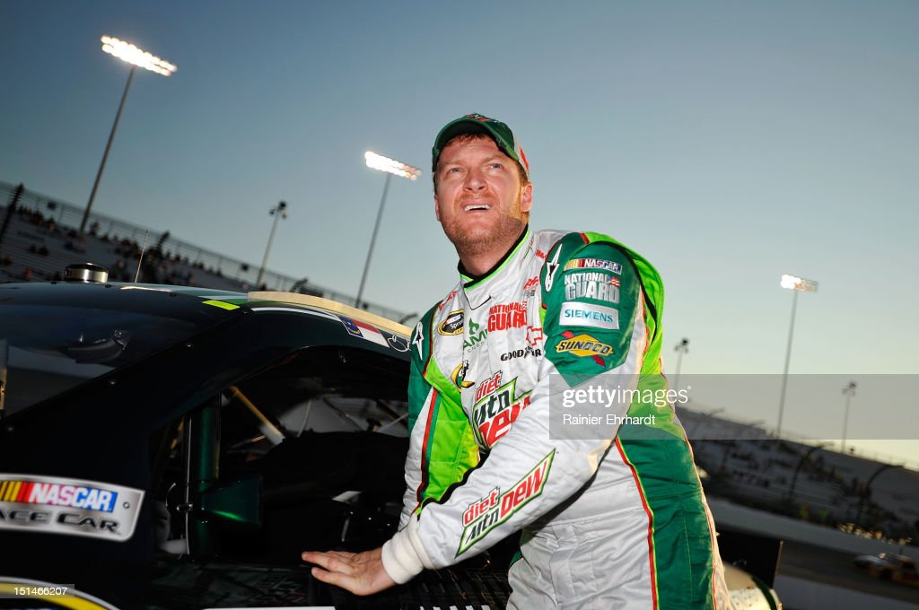 <a gi-track='captionPersonalityLinkClicked' href=/galleries/search?phrase=Dale+Earnhardt+Jr.&family=editorial&specificpeople=171293 ng-click='$event.stopPropagation()'>Dale Earnhardt Jr.</a>, driver of the #88 Diet Mountain Dew/National Guard Chevrolet, stands by his car during qualifying for the NASCAR Sprint Cup Series Federated Auto Parts 400 at Richmond International Raceway on September 7, 2012 in Richmond, Virginia.