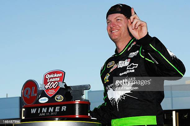 Dale Earnhardt Jr driver of the Diet Mountain Dew/TheDarkKnightRises/National Guard/ Chevrolet celebrates in Victory Lane after winning the NASCAR...