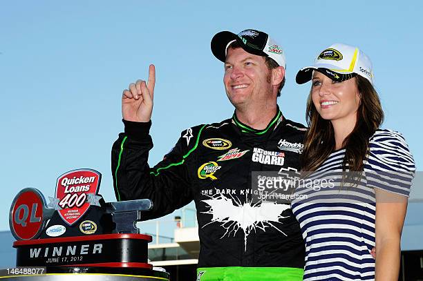 Dale Earnhardt Jr driver of the Diet Mountain Dew/TheDarkKnightRises/National Guard/ Chevrolet celebrates in Victory Lane with girlfriend Amy Reimann...