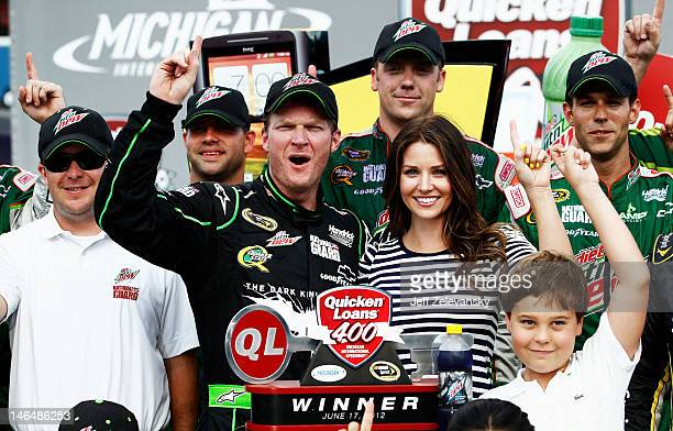 Dale Earnhardt Jr driver of the Diet Mountain Dew/TheDarkKnightRises/National Guard/ Chevrolet celebrates with his girlfriend Amy Reimann in Victory...