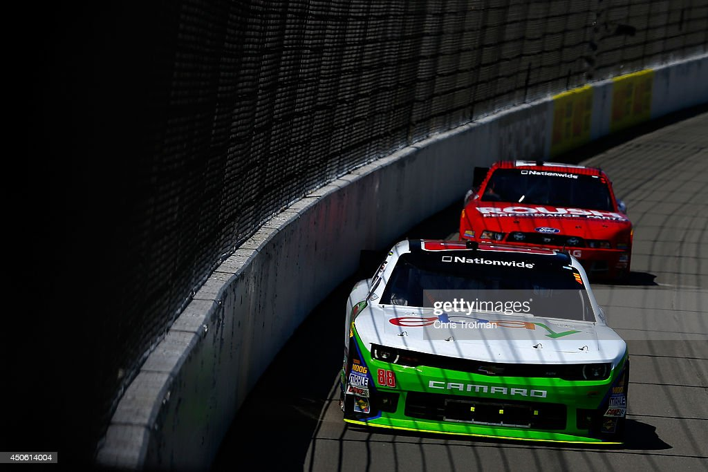 Dale Earnhardt Jr., driver of the #88 eBay Chevrolet, leads Chris Buescher, driver of the #60 Roush Performance Parts Ford, into turn one during the NASCAR Nationwide Series Ollie's Bargain Outlet 250 at Michigan International Speedway on June 14, 2014 in Brooklyn, Michigan.