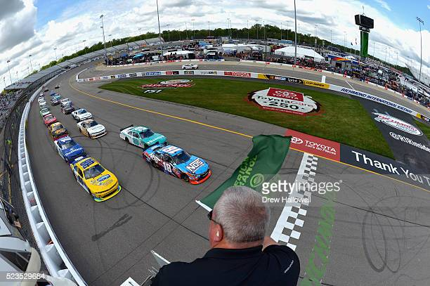 Dale Earnhardt Jr driver of the Hellmann's Chevrolet and Matt Tifft driver of the NOS Energy Drink Toyota lead the field to the green flag to start...