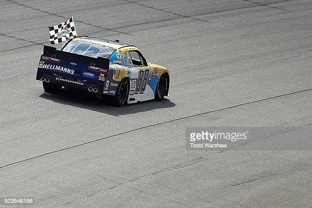 Dale Earnhardt Jr driver of the Hellmann's Chevrolet celebrates with the checkered flag after winning the NASCAR XFINITY Series ToyotaCare 250 at...