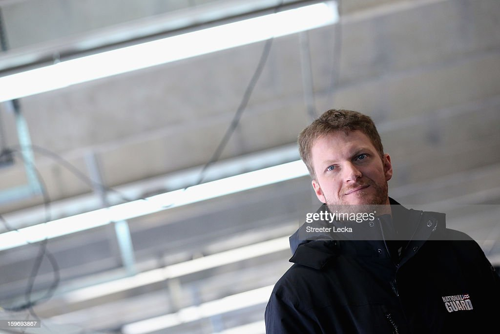Dale Earnhardt Jr., driver of the #88 Hendrick Chevrolet, looks on in the garage during NASCAR Testing at Charlotte Motor Speedway on January 18, 2013 in Charlotte, North Carolina.