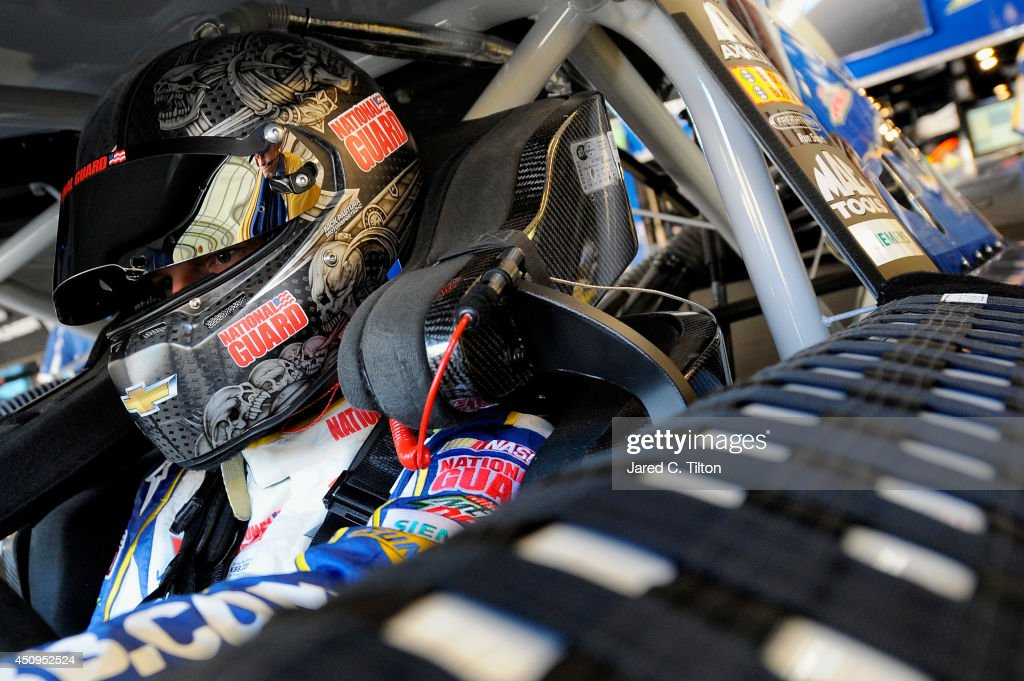 <a gi-track='captionPersonalityLinkClicked' href=/galleries/search?phrase=Dale+Earnhardt+Jr.&family=editorial&specificpeople=171293 ng-click='$event.stopPropagation()'>Dale Earnhardt Jr.</a>, driver of the #88 Kelley Blue Book Chevrolet, sits in his car during practice for the NASCAR Sprint Cup Series Toyota/Save Mart 350 at Sonoma Raceway on June 20, 2014 in Sonoma, California.