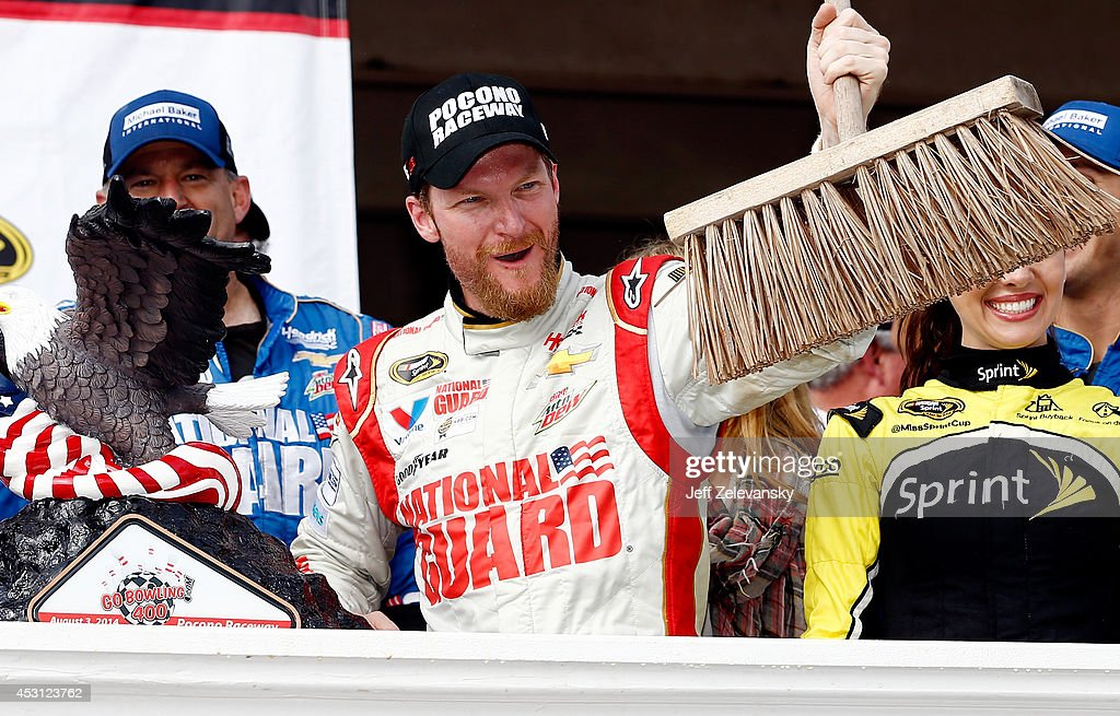 <a gi-track='captionPersonalityLinkClicked' href=/galleries/search?phrase=Dale+Earnhardt+Jr.&family=editorial&specificpeople=171293 ng-click='$event.stopPropagation()'>Dale Earnhardt Jr.</a>, driver of the #88 Michael Baker International Chevrolet, celebrates in Victory Lane after winning the NASCAR Sprint Cup Series GoBowling.com 400 at Pocono Raceway on August 3, 2014 in Long Pond, Pennsylvania.