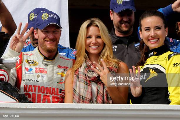 Dale Earnhardt Jr driver of the Michael Baker International Chevrolet celebrates in Victory Lane with Amy Reimann after winning the NASCAR Sprint Cup...