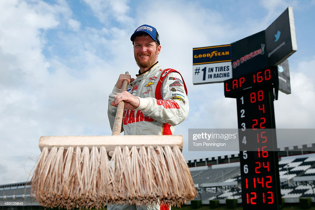 <a gi-track='captionPersonalityLinkClicked' href=/galleries/search?phrase=Dale+Earnhardt+Jr.&family=editorial&specificpeople=171293 ng-click='$event.stopPropagation()'>Dale Earnhardt Jr.</a>, driver of the #88 Michael Baker International Chevrolet, poses after winning the NASCAR Sprint Cup Series GoBowling.com 400 at Pocono Raceway on August 3, 2014 in Long Pond, Pennsylvania.