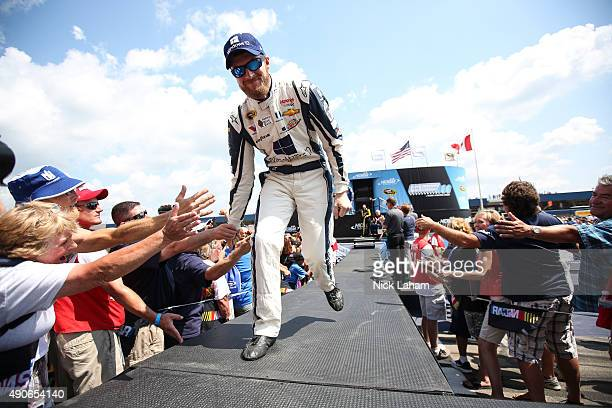 Dale Earnhardt Jr driver of the Microsoft Chevrolet greets fans during the NASCAR Sprint Cup Series Pure Michigan 400 at Michigan International...