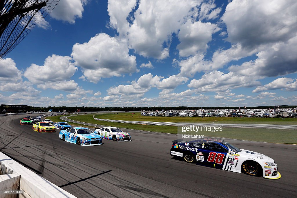 Dale Earnhardt Jr driver of the Microsoft Chevrolet leads a pack of cars during the NASCAR Sprint Cup Series Windows 10 400 at Pocono Raceway on...