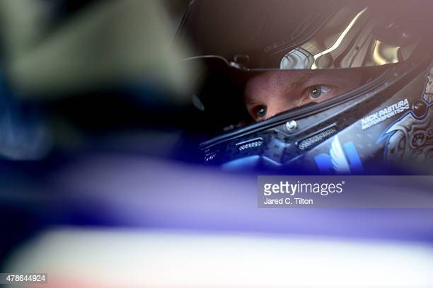 Dale Earnhardt Jr driver of the Microsoft Chevrolet sits in his car during practice for the NASCAR Sprint Cup Series Toyota/Save Mart 350 at Sonoma...