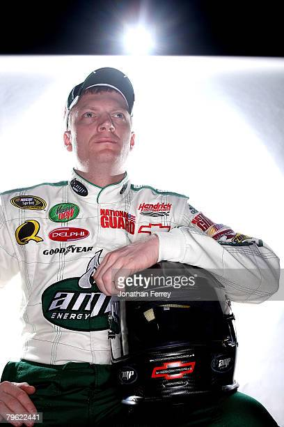 Dale Earnhardt Jr driver of the Mountain Dew AMP/National Guard Chevrolet poses for a photo during the NASCAR Sprint Cup Series media day at Daytona...