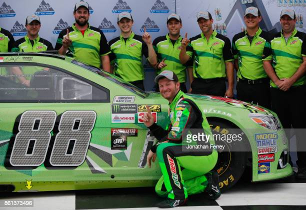 Dale Earnhardt Jr driver of the Mountain Dew Chevrolet and his team pose with the Coors Light Pole Award after qualifying in the pole position for...