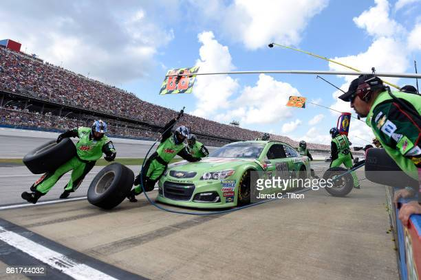 Dale Earnhardt Jr driver of the Mountain Dew Chevrolet pits during the Monster Energy NASCAR Cup Series Alabama 500 at Talladega Superspeedway on...