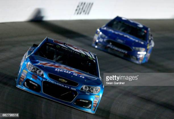 Dale Earnhardt Jr driver of the Mountain Dew DEWSA Chevrolet races during the Monster Energy NASCAR Cup Series Go Bowling 400 at Kansas Speedway on...