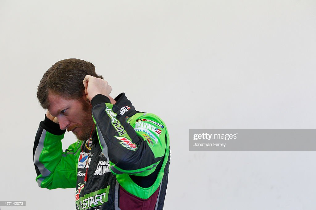 Dale Earnhardt Jr., driver of the #88 Mountain Dew Kickstart Chevrolet, stands in the garage area during practice for the NASCAR Sprint Cup Series Kobalt 400 at Las Vegas Motor Speedway on March 7, 2014 in Las Vegas, Nevada.