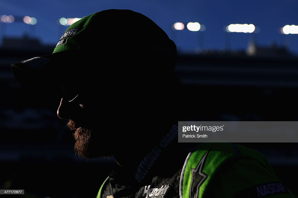 Dale Earnhardt Jr., driver of the #88 Mountain Dew Kickstart Chevrolet, stands on the grid during qualifying for the NASCAR Sprint Cup Series Kobalt 400 at Las Vegas Motor Speedway on March 7, 2014 in Las Vegas, Nevada.