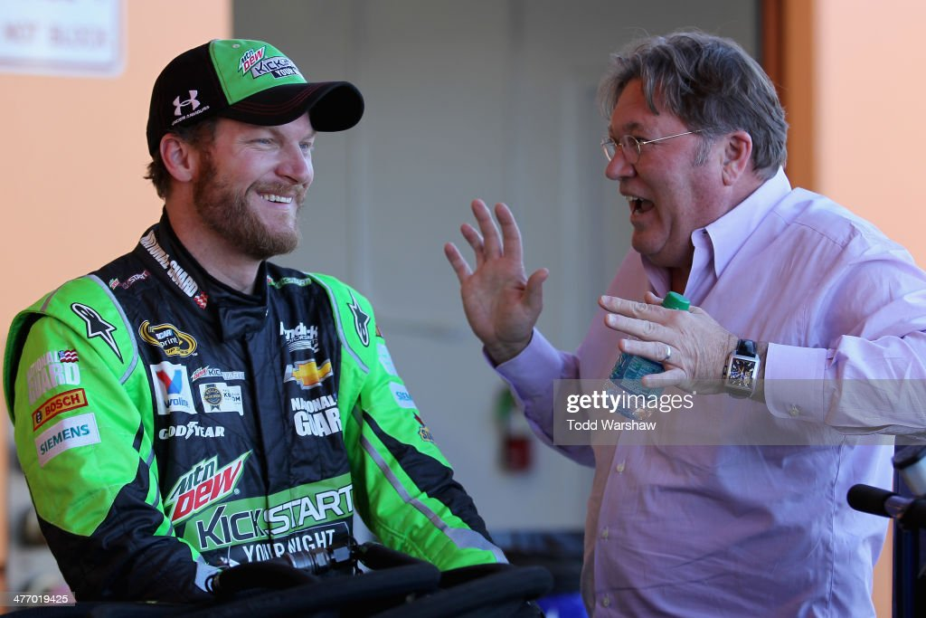 Dale Earnhardt Jr., driver of the #88 Mountain Dew Kickstart Chevrolet, talks with Robin Pemberton, vice president of competition for NASCAR, during a testing session at Las Vegas Motor Speedway on March 6, 2014 in Las Vegas, Nevada.