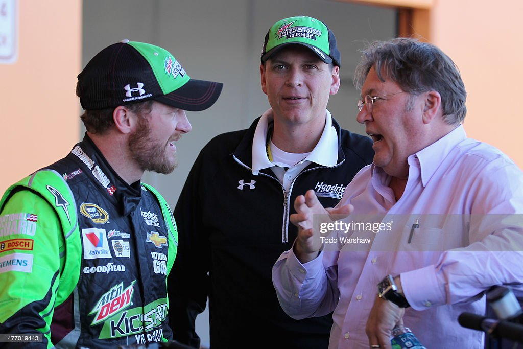 Dale Earnhardt Jr., driver of the #88 Mountain Dew Kickstart Chevrolet, talks with crew chief Steve Letarte and Robin Pemberton, vice president of competition for NASCAR, during a testing session at Las Vegas Motor Speedway on March 6, 2014 in Las Vegas, Nevada.