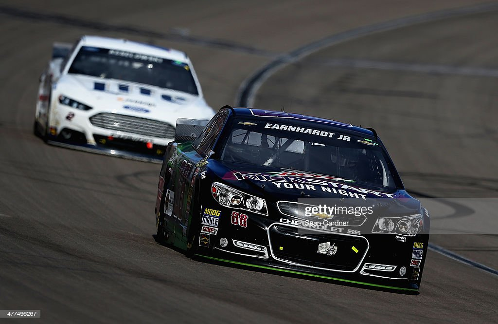 Dale Earnhardt Jr., driver of the #88 Mountain Dew Kickstart Chevrolet, leads Brad Keselowski, driver of the #2 Miller Lite Ford, during the NASCAR Sprint Cup Series Kobalt 400 at Las Vegas Motor Speedway on March 9, 2014 in Las Vegas, Nevada.