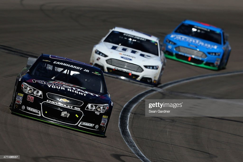 Dale Earnhardt Jr., driver of the #88 Mountain Dew Kickstart Chevrolet, leads Brad Keselowski, driver of the #2 Miller Lite Ford, and Aric Almirola, driver of the #43 Farmland Ford, during the NASCAR Sprint Cup Series Kobalt 400 at Las Vegas Motor Speedway on March 9, 2014 in Las Vegas, Nevada.