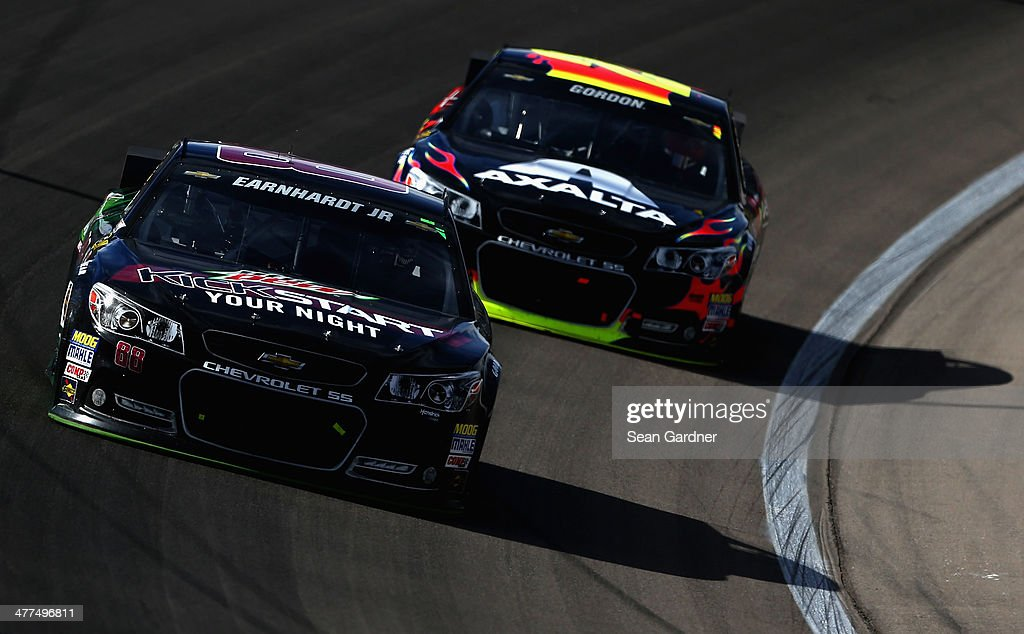 Dale Earnhardt Jr., driver of the #88 Mountain Dew Kickstart Chevrolet, leads Jeff Gordon, driver of the #24 Axalta Chevrolet, during the NASCAR Sprint Cup Series Kobalt 400 at Las Vegas Motor Speedway on March 9, 2014 in Las Vegas, Nevada.