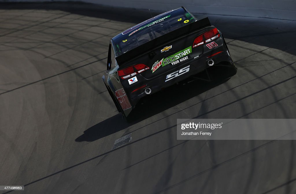 Dale Earnhardt Jr., driver of the #88 Mountain Dew Kickstart Chevrolet, races during the NASCAR Sprint Cup Series Kobalt 400 at Las Vegas Motor Speedway on March 9, 2014 in Las Vegas, Nevada.