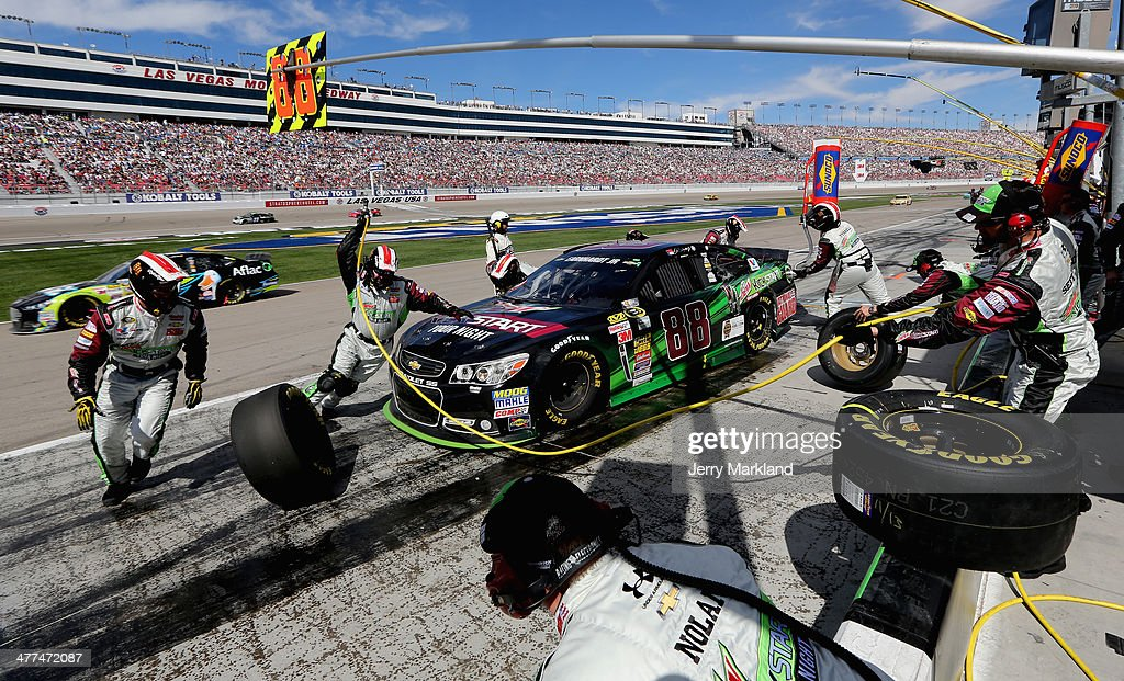 Dale Earnhardt Jr., driver of the #88 Mountain Dew Kickstart Chevrolet, pits during the NASCAR Sprint Cup Series Kobalt 400 at Las Vegas Motor Speedway on March 9, 2014 in Las Vegas, Nevada.