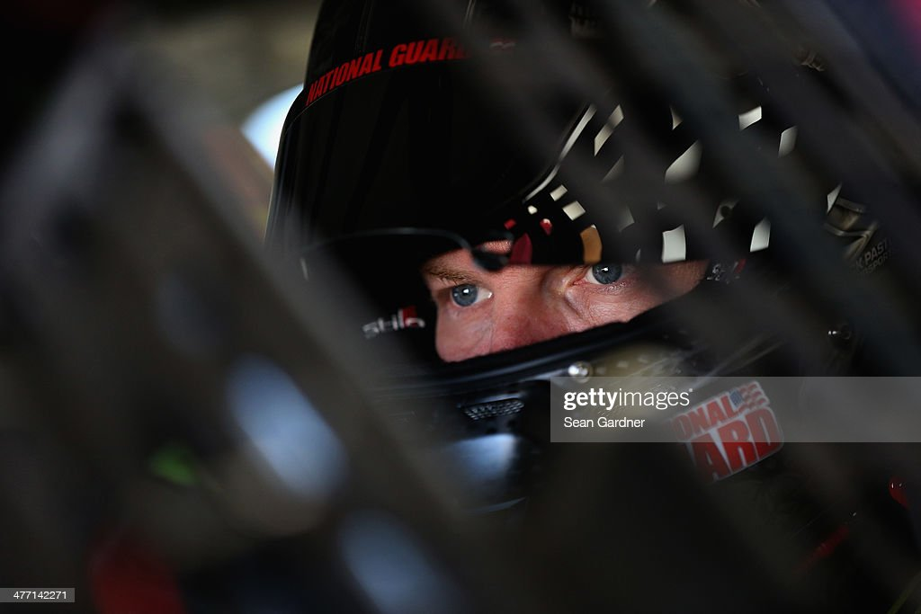 Dale Earnhardt Jr., driver of the #88 Mountain Dew Kickstart Chevrolet, sits in his car during practice for the NASCAR Sprint Cup Series Kobalt 400 at Las Vegas Motor Speedway on March 7, 2014 in Las Vegas, Nevada.