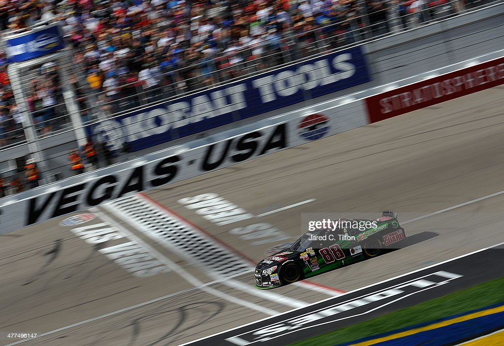Dale Earnhardt Jr., driver of the #88 Mountain Dew Kickstart Chevrolet, crosses the finish line in second place after running out of gas on the last lap during the NASCAR Sprint Cup Series Kobalt 400 at Las Vegas Motor Speedway on March 9, 2014 in Las Vegas, Nevada.