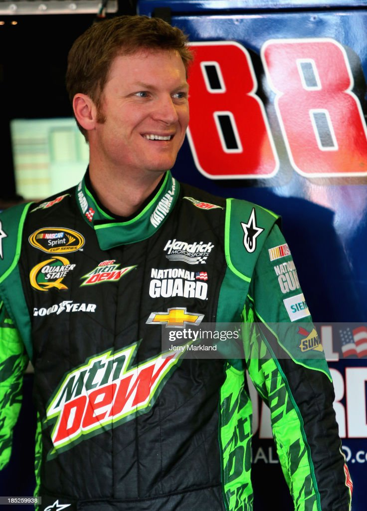 <a gi-track='captionPersonalityLinkClicked' href=/galleries/search?phrase=Dale+Earnhardt+Jr.&family=editorial&specificpeople=171293 ng-click='$event.stopPropagation()'>Dale Earnhardt Jr.</a>, driver of the #88 Mountain Dew / XBox One Chevrolet, stands in the garage area during practice for the NASCAR Sprint Cup Series 45th Annual Camping World RV Sales 500 at Talladega Superspeedway on October 18, 2013 in Talladega, Alabama.