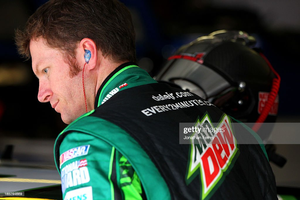 Dale Earnhardt Jr., driver of the #88 Mountain Dew / XBox One Chevrolet, stands in the garage area during practice for the NASCAR Sprint Cup Series 45th Annual Camping World RV Sales 500 at Talladega Superspeedway on October 18, 2013 in Talladega, Alabama.