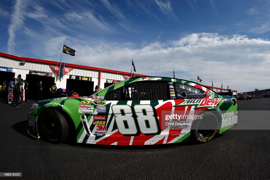 Dale Earnhardt Jr., driver of the #88 Mountain Dew / XBox One Chevrolet, drives in the garage area during practice for the NASCAR Sprint Cup Series 45th Annual Camping World RV Sales 500 at Talladega Superspeedway on October 18, 2013 in Talladega, Alabama.