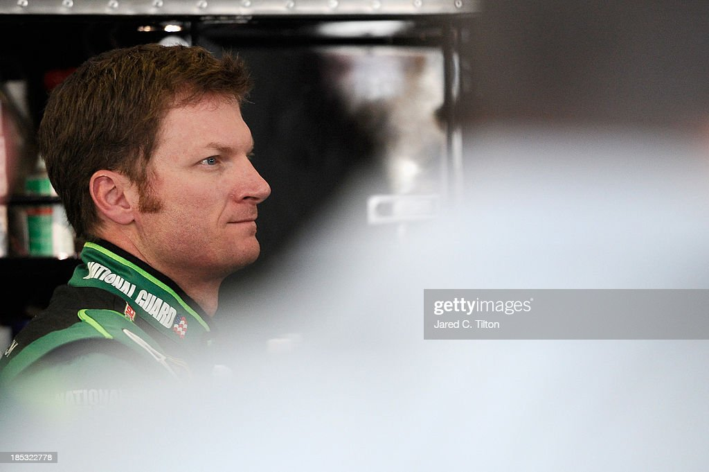 Dale Earnhardt Jr., driver of the #88 Mountain Dew / XBox One Chevrolet, stands in the garage during practice for the NASCAR Sprint Cup Series 45th Annual Camping World RV Sales 500 at Talladega Superspeedway on October 18, 2013 in Talladega, Alabama.