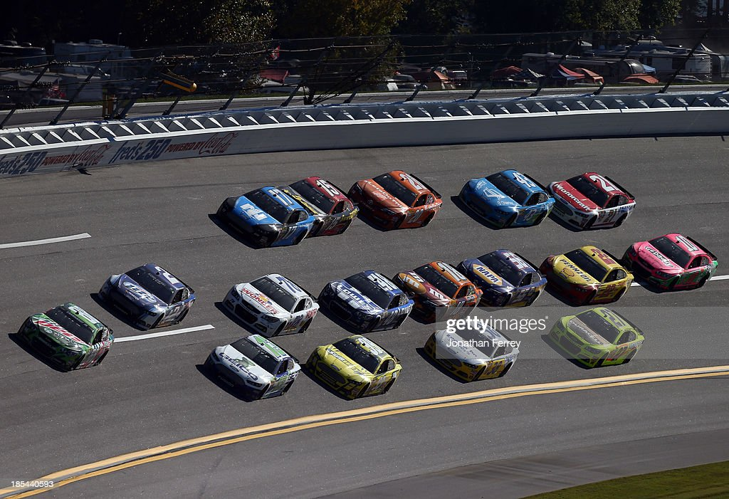 Dale Earnhardt Jr., driver of the #88 Mountain Dew / XBox One Chevrolet, leads a pack of cars during the NASCAR Sprint Cup Series Camping World RV Sales 500 at Talladega Superspeedway on October 20, 2013 in Talladega, Alabama.