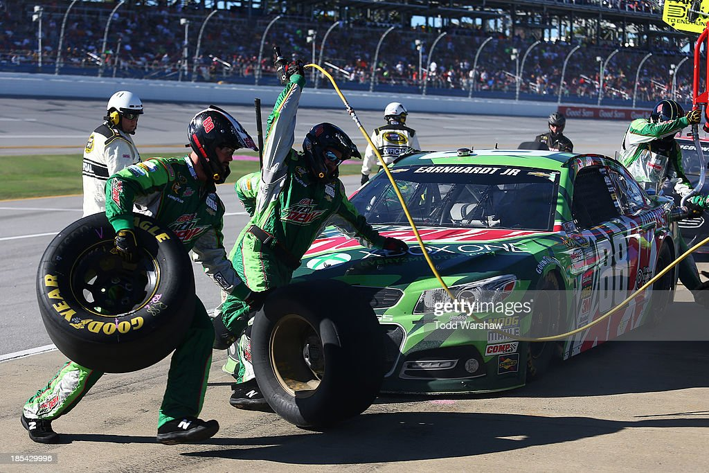 Dale Earnhardt Jr., driver of the #88 Mountain Dew / XBox One Chevrolet, pits during the NASCAR Sprint Cup Series Camping World RV Sales 500 at Talladega Superspeedway on October 20, 2013 in Talladega, Alabama.