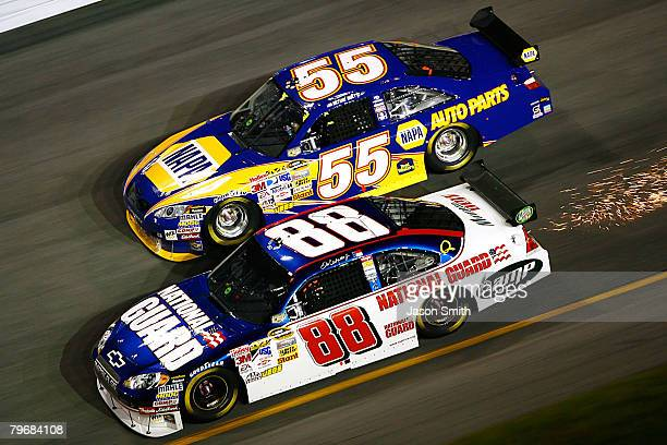 Dale Earnhardt Jr driver of the Mountian Dew AMP/National Guard Chevrolet races along side Michael Waltrip driver of the NAPA Auto Parts Toyota in...