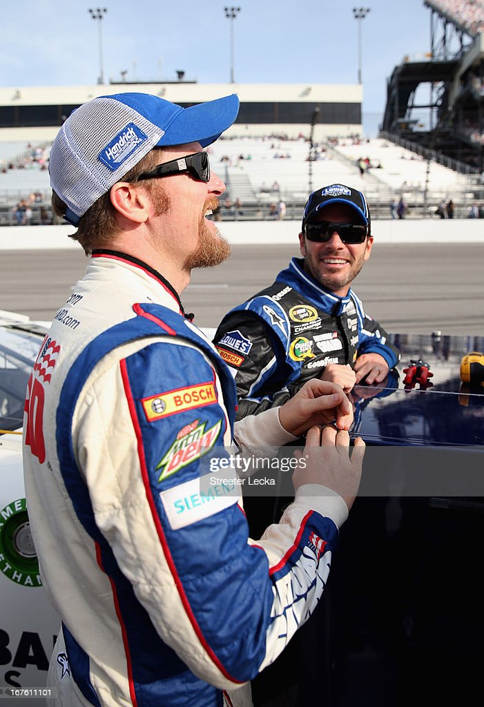 <a gi-track='captionPersonalityLinkClicked' href=/galleries/search?phrase=Dale+Earnhardt+Jr.&family=editorial&specificpeople=171293 ng-click='$event.stopPropagation()'>Dale Earnhardt Jr.</a>, driver of the #88 National Guard Chevrolet, and <a gi-track='captionPersonalityLinkClicked' href=/galleries/search?phrase=Jimmie+Johnson+-+Nascar+Race+Driver&family=editorial&specificpeople=171519 ng-click='$event.stopPropagation()'>Jimmie Johnson</a>, driver of the #48 Lowe's Dover White Chevrolet, talk on the grid during qualifying for the NASCAR Sprint Cup Series Toyota Owners 400 at Richmond International Raceway on April 26, 2013 in Richmond, Virginia.
