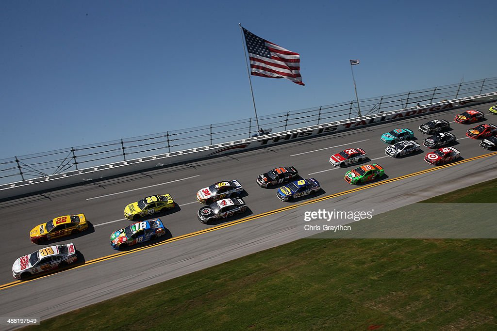 Dale Earnhardt Jr., driver of the #88 National Guard Chevrolet, and Joey Logano, driver of the #22 Shell-Pennzoil Ford, lead the field during the NASCAR Sprint Cup Series Aaron's 499 at Talladega Superspeedway on May 4, 2014 in Talladega, Alabama.