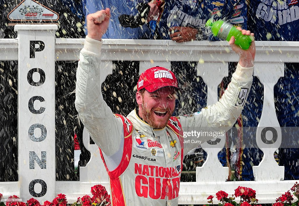 <a gi-track='captionPersonalityLinkClicked' href=/galleries/search?phrase=Dale+Earnhardt+Jr.&family=editorial&specificpeople=171293 ng-click='$event.stopPropagation()'>Dale Earnhardt Jr.</a>, driver of the #88 National Guard Chevrolet, celebrates in Victory Lane after winning during the NASCAR Sprint Cup Series Pocono 400 at Pocono Raceway on June 8, 2014 in Long Pond, Pennsylvania.