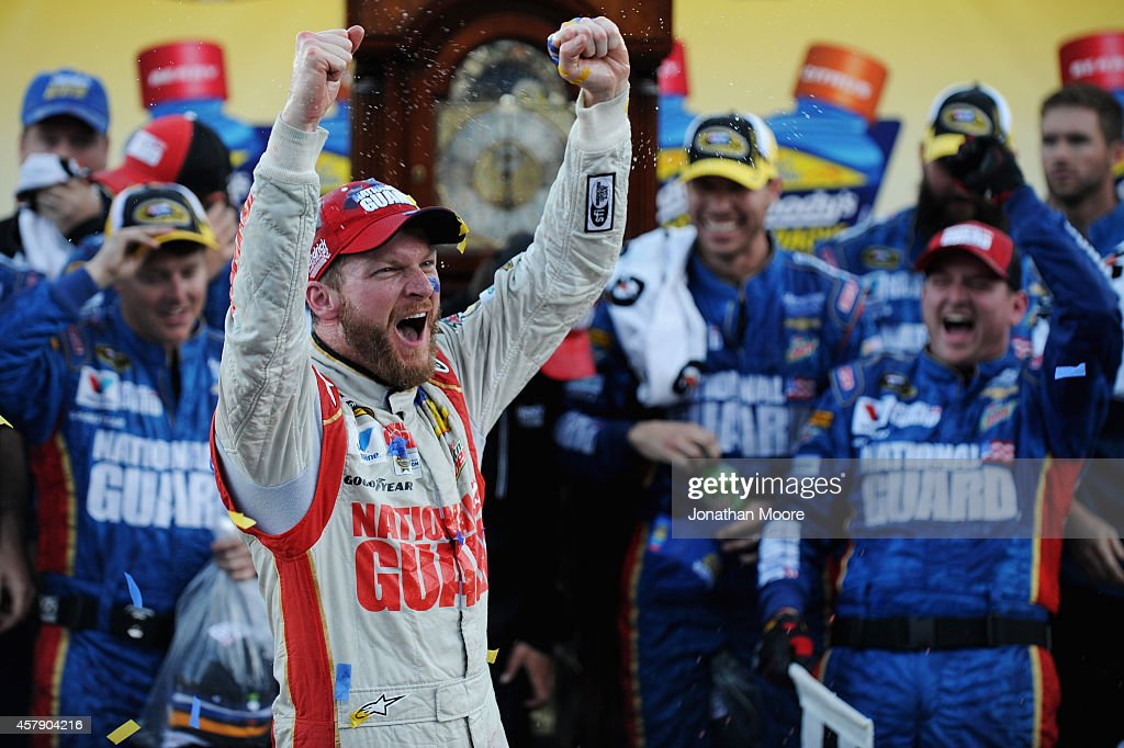 <a gi-track='captionPersonalityLinkClicked' href=/galleries/search?phrase=Dale+Earnhardt+Jr.&family=editorial&specificpeople=171293 ng-click='$event.stopPropagation()'>Dale Earnhardt Jr.</a>, driver of the #88 National Guard Chevrolet, celebrates in Victory Lane after winning during the NASCAR Sprint Cup Series Goody's Headache Relief Shot 500 at Martinsville Speedway on October 26, 2014 in Martinsville, Virginia.