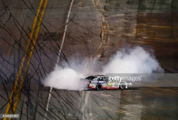 Dale Earnhardt Jr driver of the National Guard Chevrolet celebrates with a burnout after winning the NASCAR Sprint Cup Series Daytona 500 at Daytona...
