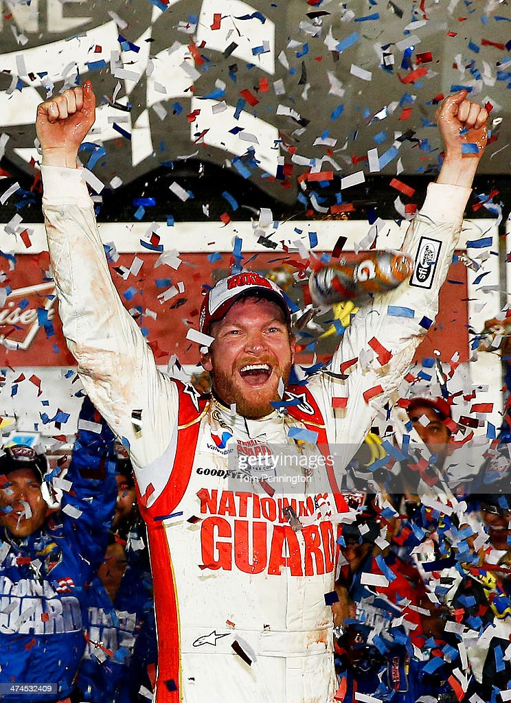 <a gi-track='captionPersonalityLinkClicked' href=/galleries/search?phrase=Dale+Earnhardt+Jr.&family=editorial&specificpeople=171293 ng-click='$event.stopPropagation()'>Dale Earnhardt Jr.</a>, driver of the #88 National Guard Chevrolet, celebrates in Victory Lane after winning the NASCAR Sprint Cup Series Daytona 500 at Daytona International Speedway on February 23, 2014 in Daytona Beach, Florida.