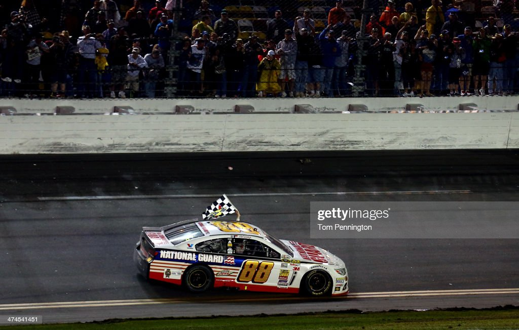 Dale Earnhardt Jr., driver of the #88 National Guard Chevrolet, celebrates with the checkered flag after winning the NASCAR Sprint Cup Series Daytona 500 at Daytona International Speedway on February 23, 2014 in Daytona Beach, Florida.